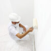 Smart antimicrobial whiteboard paint being applied to wall