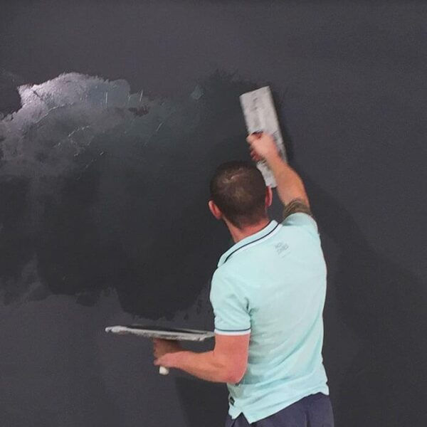 Contractor applying smart magnetic plaster to wall