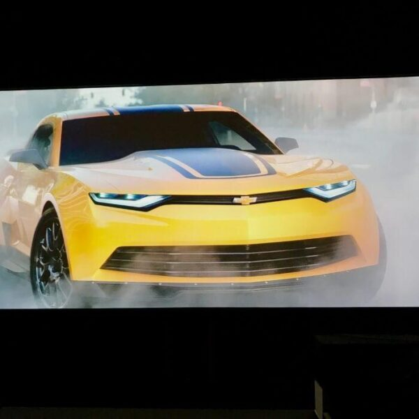 Image of car chase projected onto wall with projector paint pro