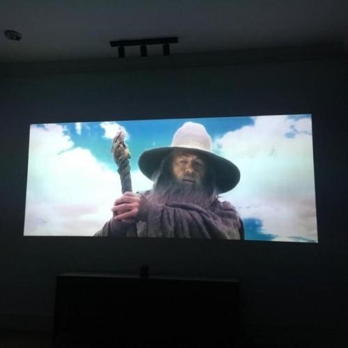 Movie projected on wall with smart projector paint contrast